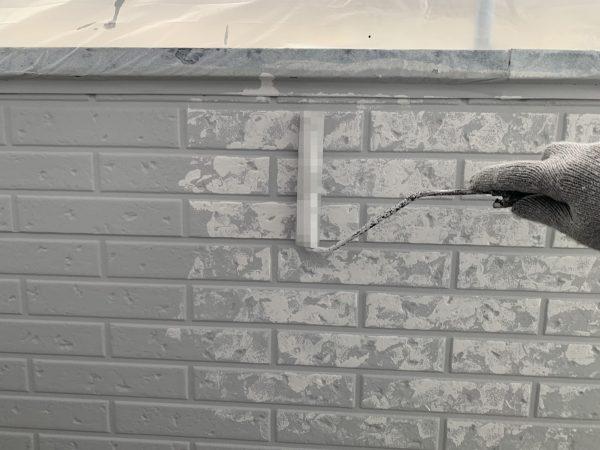 外壁のWBアートB色塗装作業状況